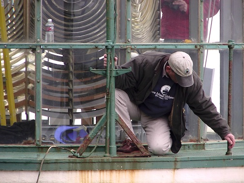 Cullen inspects metalwork on the Heceta Head Lighthouse lantern in 2001.