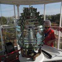 Dorothy Jarczynski looking at the 5th order Fresnel Lens in the Biloxi Lighthouse
