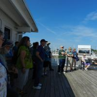 The group listing to the tour guide give her talk on the New Canal Lighthouse