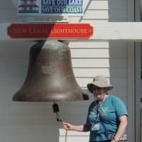 Anita Norris ringing the fog bell at New Canal Lighthouse