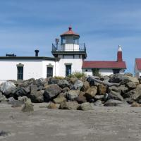 West Point Lighthouse sits on the west side of the entrance to the port of Seattle in Discovery Park