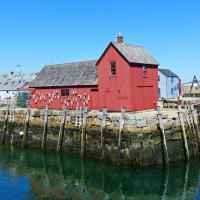 """Motif Number 1, located on Bradley Wharf in the harbor town of Rockport is a fishing shack known to students of art and art history as """"the most often-painted building in America"""