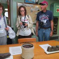 Kathleen, Holly and Tony listen intently as Captain Mike describes the different types of minerals that are found in Lake Huron.