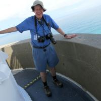 Tom and his trusty cameras ready to photograph the fantastic view from a windy Cape Bryon's gallery.