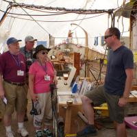 Saxon Bisbee, Archaeologist and Vessel Manager, talks to Portia, Allan and Larry about restoration efforts