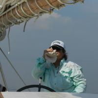 The Skipper blowing the horn that we are entering the harbor