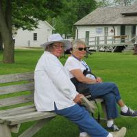 Dorothy and Jewell Ann take a bench breather after visiting the museum and gift shop at Point Aux Barques.