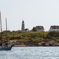 Originally, Baker Island had a set of twin lights but the smaller of the two towers was dismantled in 1926.  The taller tower remains active today.