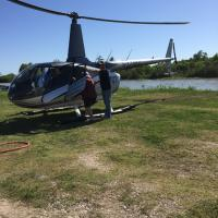 Chris getting on helicopter