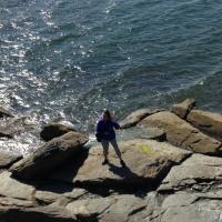Carol on the beach at Rose Island Lighthouse