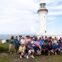 The group and four of our hosts (front row) in front of the beautiful Norah Head Lighthouse.