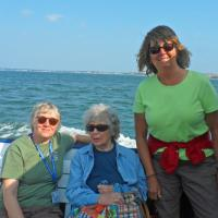 The warm sunshine of Boston Narbor was enjoyed by all, including Leah, Dona and Carol.