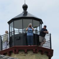 Mary takes a picture as Rich looks on after climbing to the replica lantern