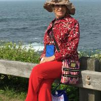 Patricia taking a relaxing moment at Beavertail Lighthouse