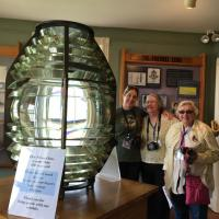 Megan, Amy & Ann at the Fresnel Lens display at Beavertail Lighthouse