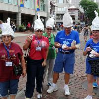 """Laurel, Marge, Esther, Bill and Peggy show off the hats that were created for them at Dick's Last Resort restaurant during their lunch at Boston's Quincy Market.  I will leave it to you to read the writing on their hats (except for Peggy's which says """"I'm with stupid."""")"""