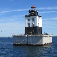 A lightship originally marked the spot of the Poe Reef Lighthouse.  Built in just 12 feet of water it marks the eastern entrance into the South Channel.  As an active aid to navigation, the light and fog horn are still in operation.