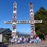 The group at the Jamestown S'Klallam Tribe's Dance Plaza House Posts (totems)
