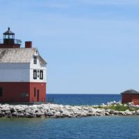 Round Island guides ships thru the north channel.  The red-brick lighthouse is beautifully maintained and acts as a private navigational aide.