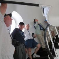 Skip, Dick, Retta and Mary patiently wait to climb the steps up to Point Perpendicular's lantern room.
