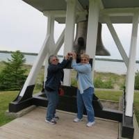 Laurel and Marge ring the bell at Old Presque Isle to let everyone know it was time to board the bus.