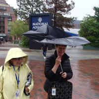 Kathryn and Peggy with damaged umbrella trying to stay dry in Baltimore Harbor