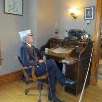 The keeper at New Presque Isle sat as his desk and waited for our arrival.  Unfortunately, since he was a wax figure, he couldn't provide much information about his duties and responsibilities at the light.