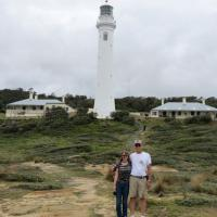 Cassandra and Jerry pose in front of the Point Hicks Light Station in Victoria.