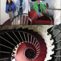 Ann, Jan and Anita climb the colorful stairway to see the Chance Brothers first-order lens in the Point Hicks Lighthouse.