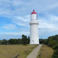 Cape Schanck Lighthouse features a rotating Chance Brothers first-order lens and a stone stairway.