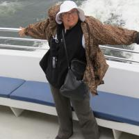 As our boat gained speed leaving the harbor, A.J. felt the wind in her sails