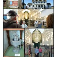 The Westport Maritime Museum and lens building.  Joan and Bill stand in the shadow of the huge First Order Fresnel Lens