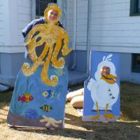 Bruce, the octopus, and Mary, the sea gull, hang around waiting to go to the lighthouse