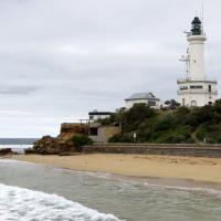 Point Lonsdale Lighthouse consists of a concrete tower surrounded by a 2-story octagonal signal station and observation room.