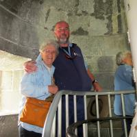 Marguerite is all smiles as she gets a hug from our Cape Otway Lighthouse guide.