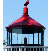 The light is an active aid to navigation and displays a fixed red light