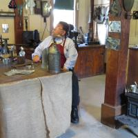 The tinsmith demonstrated how several items were made during the 1880's.