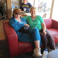 Candace and Mary are smiling because they are cooling off in the air-conditioned café.