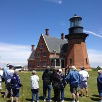 Group listening to the docent at the Block Island SE Lighthouse