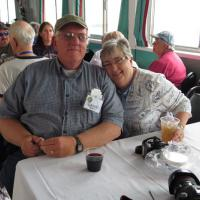 Larry and Jan finish dinner and anxiously await the auction!