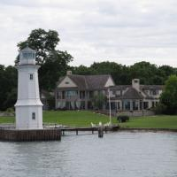 Grosse Isle Light is the only light left from a series of lights established along the Detroit River.  The keeper's house still exists, is privately owned and it is NOT the house in the background.