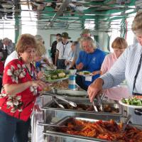 Norma and company pass through the buffet line.