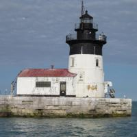 The Detroit River Lighthouse replaced a lightship in 1885. The light station has the appearance of a vessel, with the pointed end directed toward the mouth of the river to break ice flows coming down river.