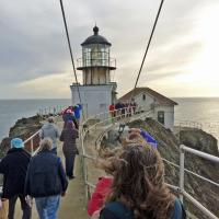 Crossing the suspension bridge to the lighthouse.