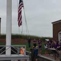 Bill raising the flag at Fort McHenry