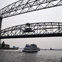 The lift bridge is raised and lowered for small boats.