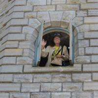 Holly stops to wave as she climbs the tower