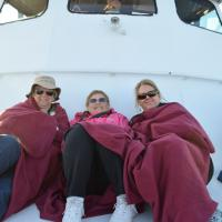 Portia, Marge and Wanda prepared for the sunset voyage in Lake Superior.