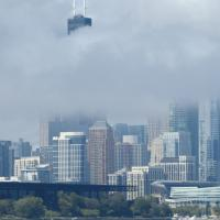 A view of the city blanketed with fog