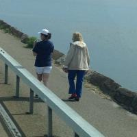 Megan & Patricia walking along the bridge to get a view of Lynde Point Lighthouse and Saybrooke Breakwater